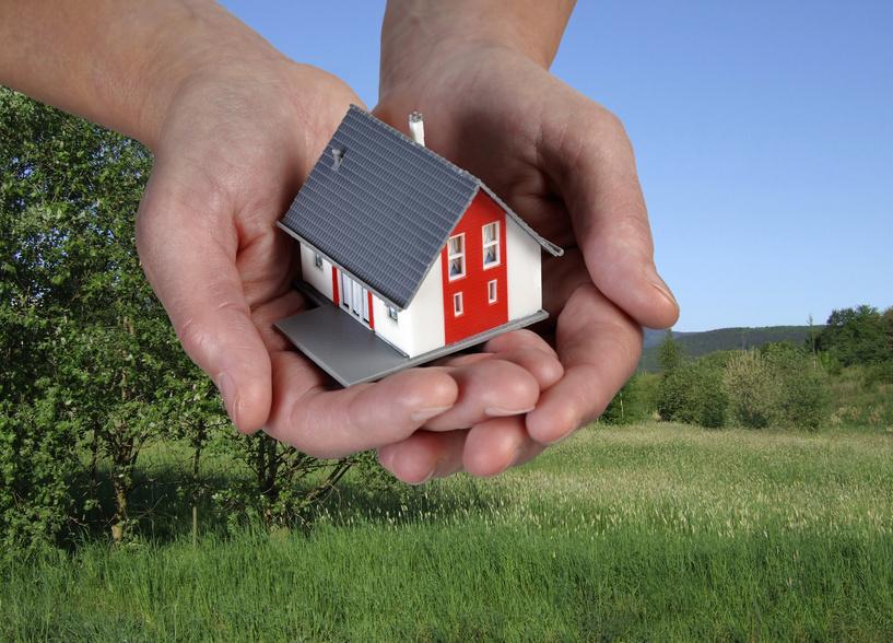 Haus in Händen